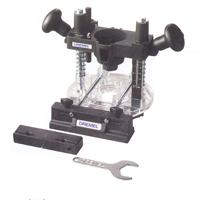 """Outil rotatif DREMEL (DR) - Un catalogue des accessoires et des pièces est disponible lors dun prêt. Chacun de nos outils est prêté dans un coffret qui contient un kit de base (l'outil lui-même, une clé de serrage, une tige pour manchon abrasif et une tige pour disque de tronçonnage).<br /> <br /> AVERTISSEMENT : Vous devez fournir les éléments """"consommables"""" comme les manchons abrasifs et les disques de tronçonnage.  Ces éléments sont vendus en petits paquets dans les quincailleries qui distribuent les produits DREMEL.<br /> <br /> Nous disposons aussi de quelques accessoires spécialisés : kit pour transformer l'outil en toupie (moins les fers à toupiller que vous devez fournir), kit pour montage de l'outil sous un établi et le transformer en table à toupiller."""